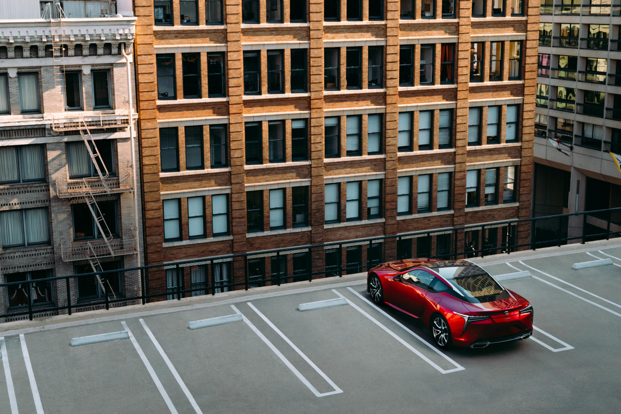 Red Lexus LC on parking garage in San Francisco