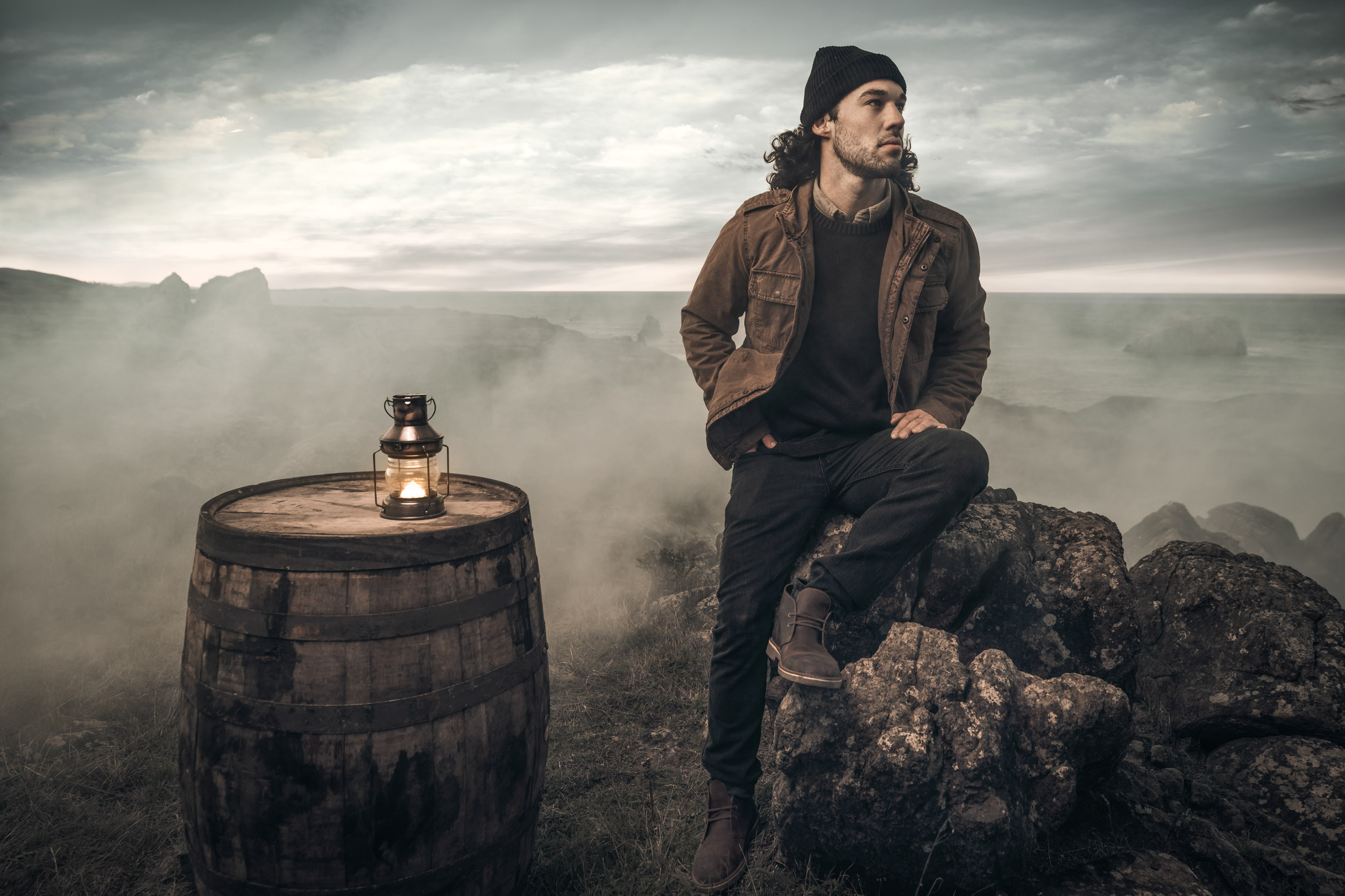 A lone bootlegger sits in the fog near a barrel of  Redwood Empire whiskey