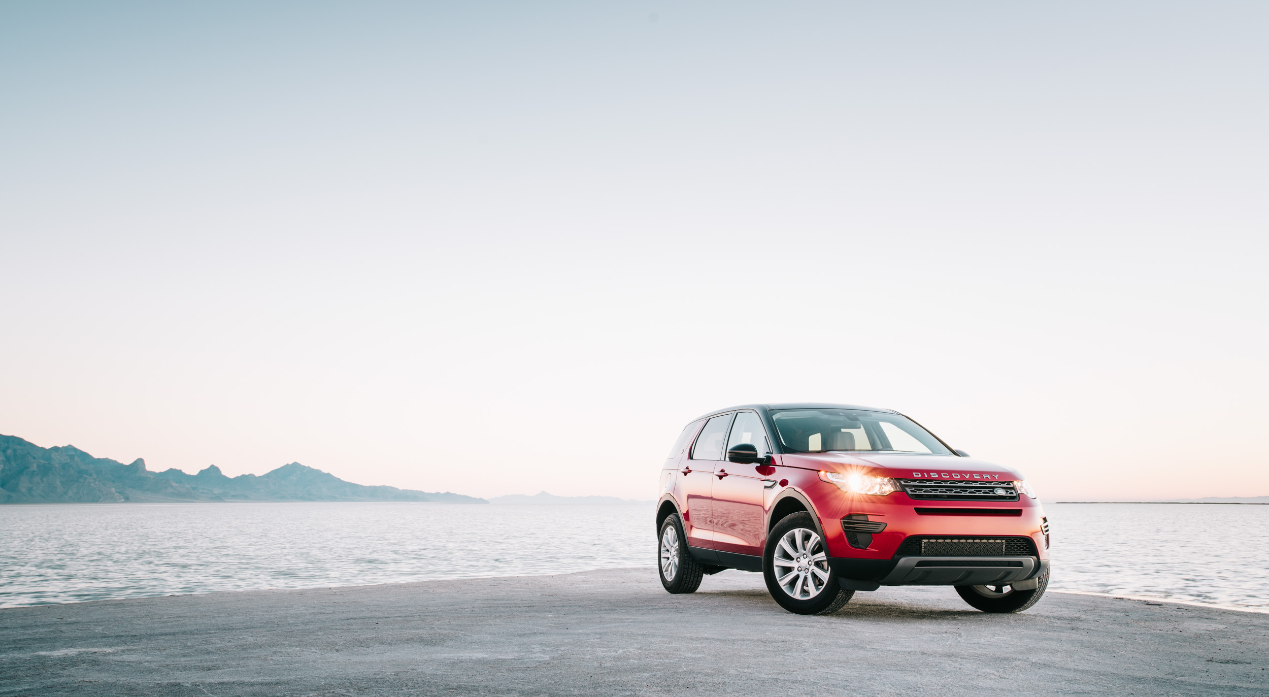 A red Land Rover Discovery on the Great Salt Flats in Utah