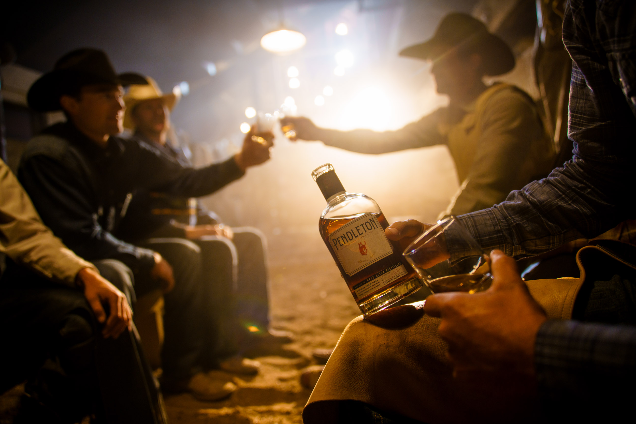 Pendleton Round Up cowboys enjoying a post-rodeo celebration whiskey drink.
